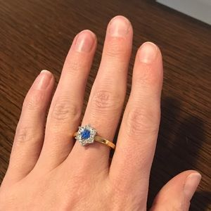 Jewelry - Gold ring with blue center gemstone